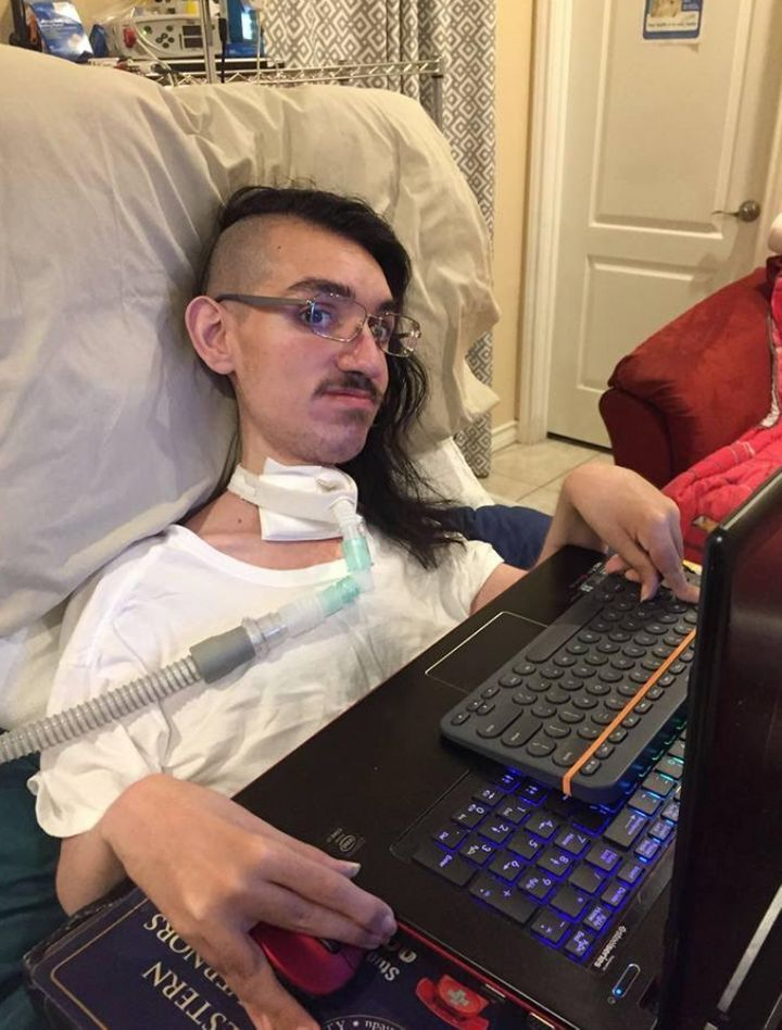 Gabe with his new computer (August 2018).