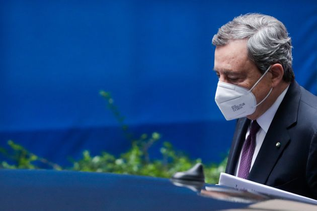 Italian Prime Minister Mario Draghi leaves after a two day EU summit at the European Council building...