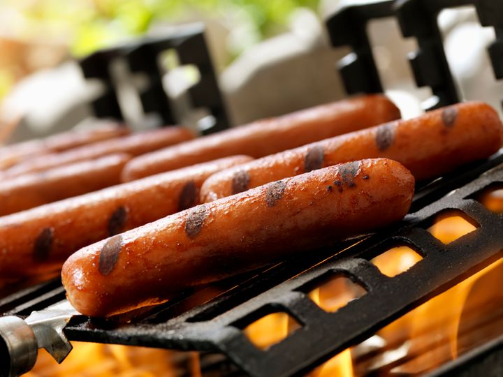 Start grilled hot dogs over low heat and finish them over higher heat.
