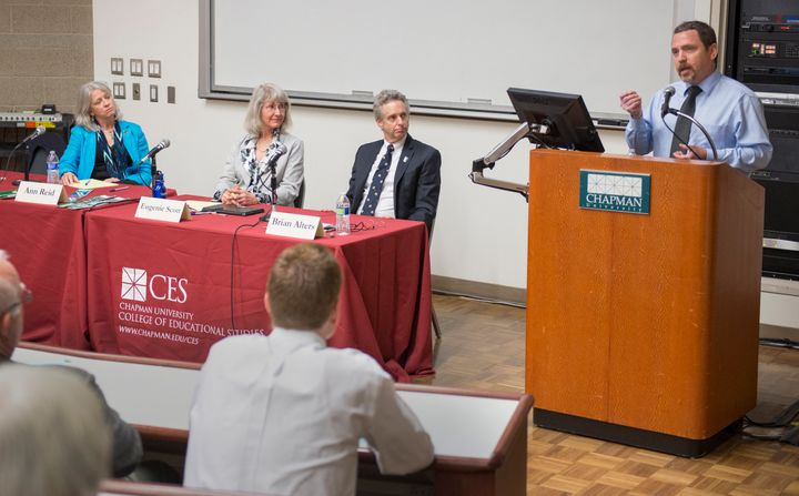 Climate change and atmospheric scientist Ben Santer, at the podium on the right, speaks during open panel discussion on evolu