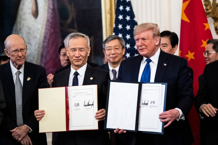 Donald Trump signs a trade agreement with Chinese Vice Premier Liu He in the East Room at the White House on Jan. 15, 2020, i