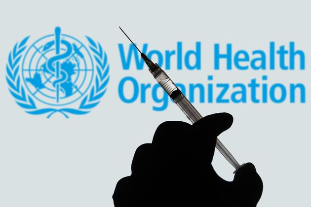 BRAZIL - 2021/04/02: In this photo illustration, a hand holds a medical syringe with a World Health Organization...
