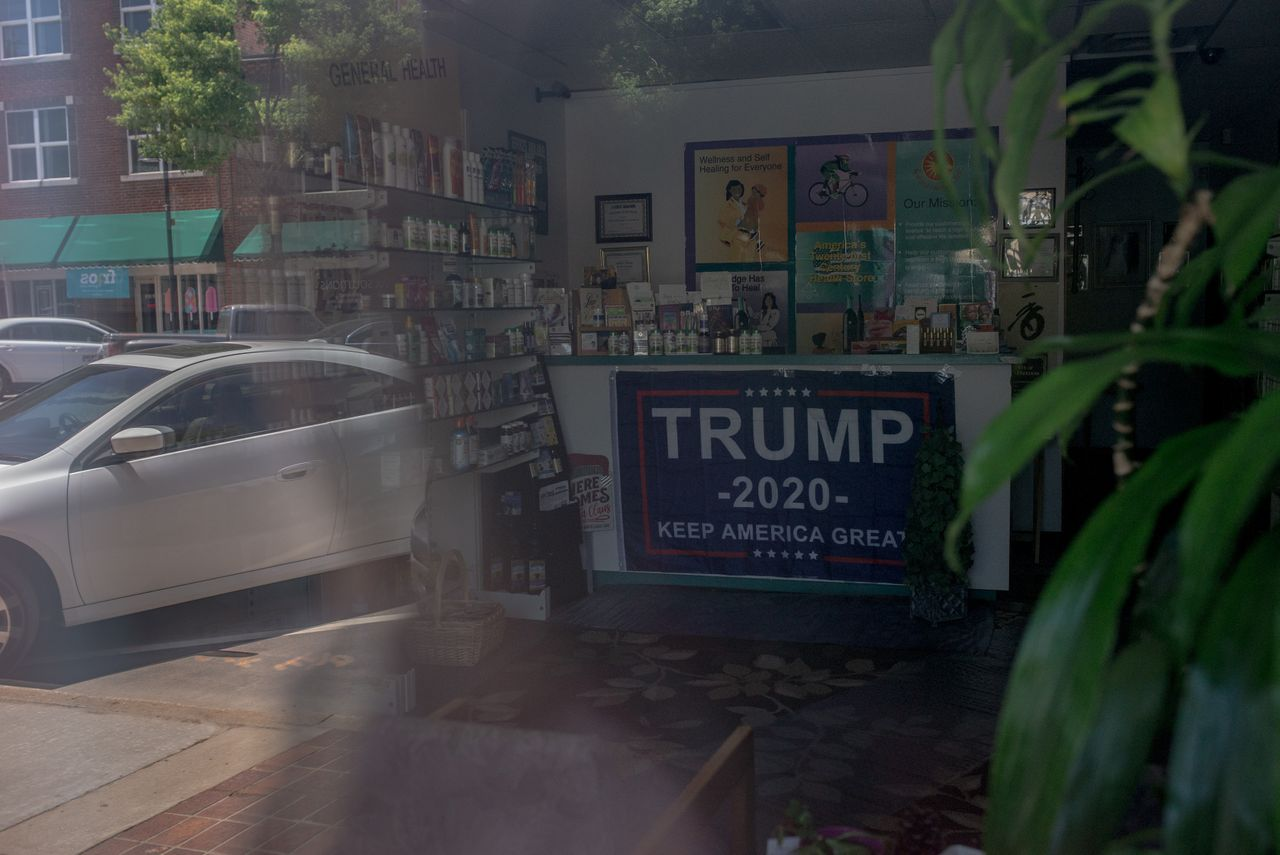 A Trump banner hangs on the front desk of Natural Health Clinic, located on Black Wall Street.