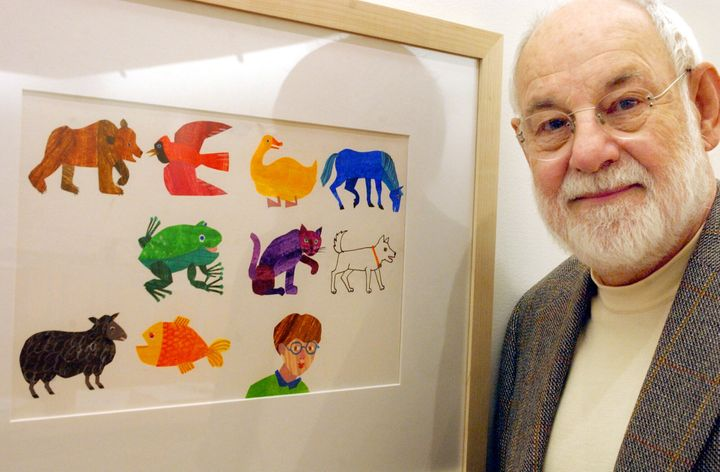 Eric Carle, an illustrator and author of children's books, with a print of some of his illustrations. Carle died on May