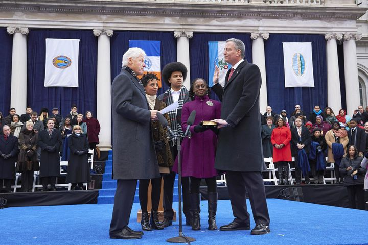New York City Mayor Bill de Blasio, right, takes the oath of office in 2014. Progressives rejoiced at de Blasio's election, b