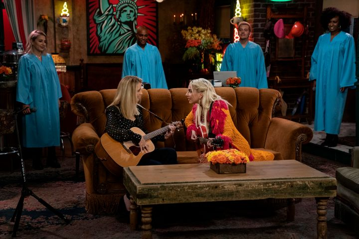 """Lisa Kudrow and Lady Gaga, backed by a choir, perform """"Smelly Cat."""""""