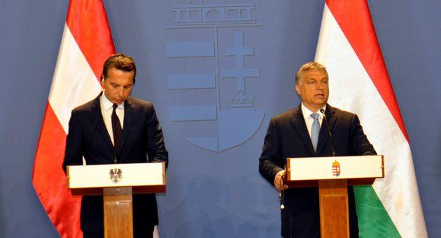 BUDAPEST, HUNGARY - JULY 26: Austrian Chancellor Christian Kern (L) and Hungarian Prime Minister Viktor...