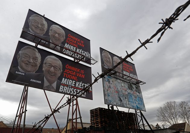 BUDAPEST, HUNGARY - FEBRUARY 22: A billboard seen with portraits of European Commission chief Jean-Claude...