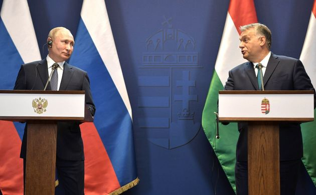 Russian President Vladimir Putin (L) and Prime Minister of Hungary, Viktor Orban (R) hold a joint press...