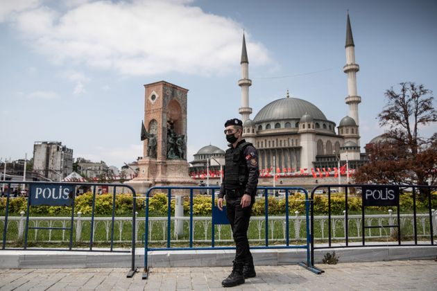 ISTANBUL, TURKEY - MAY 28: A police officer stands guard in front of the newly completed Taksim Mosque...