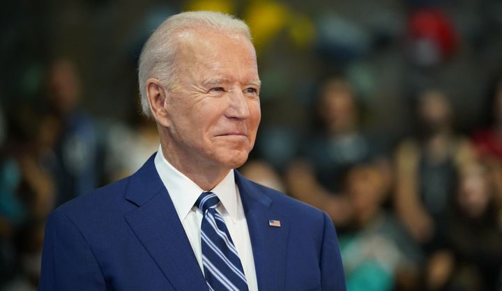 President Joe Biden waits to speak as he visits the Sportrock Climbing Centers in Alexandria, Virginia, on May 28.