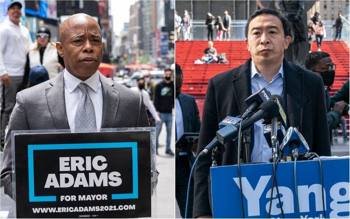 Eric Adams, left, and Andrew Yang held dueling press conferences in Times Square the day after three tourists were shot. Crime has become the central issue in New York's mayoral race.