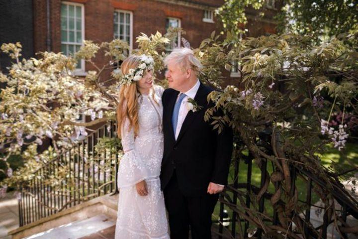 U.K. Prime Minister Boris Johnson (right) married partner Carrie Symonds over the weekend.