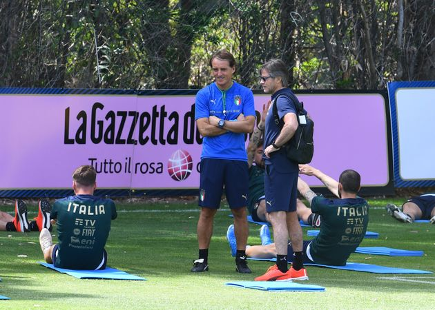 SANTA MARGHERITA DI PULA, ITALY - MAY 26: Head coach of Italy Roberto Mancini and team manager Gabriele...