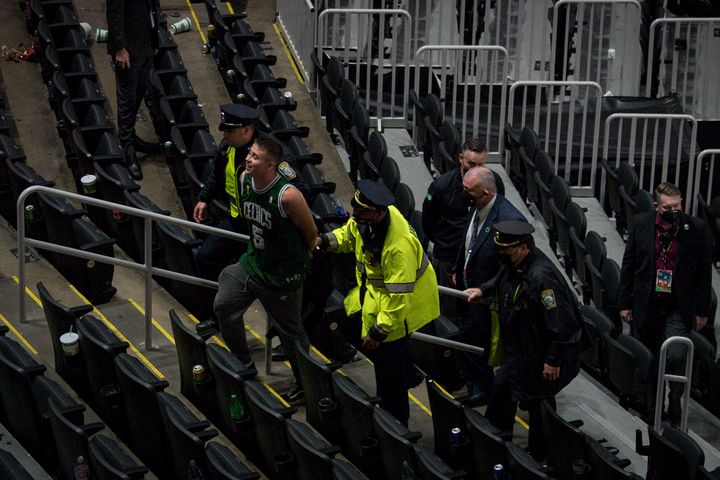 A Boston Celtics fan was arrested after throwing a water bottle at Kyrie Irving of the Brooklyn Nets.
