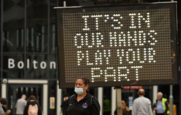 A public health digital board advises the public to follow the coronavirus rules as a Covid-19 variant...