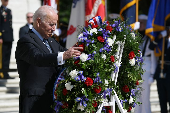 President Joe Biden takes part in a wreath-laying in front of Tomb of the Unknown Soldier at Arlington National Cemetery on M