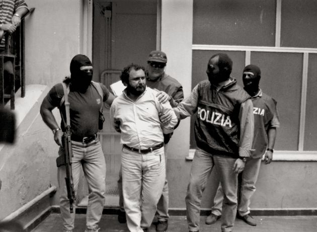 (DOUBLE RATES APPLY) Policemen escorting Italian mafioso Giovanni Brusca who has just been arrested....