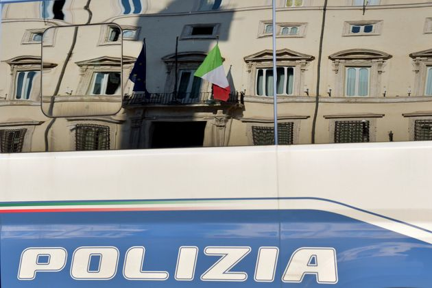 ROME, ITALY - FEBRUARY 02: The facade of Palazzo Chigi, seat of the Italian Government, reflected in...