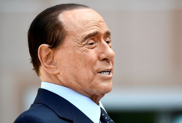 Former Italian Prime Minister Silvio Berlusconi speaks to the media as he leaves San Raffaele hospital...