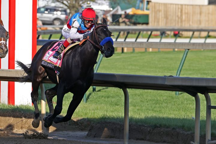 Medina Spirit ridden by John Velasquez leads the Kentucky Derby en route to victory in the May 1 Triple Crown race. But the t
