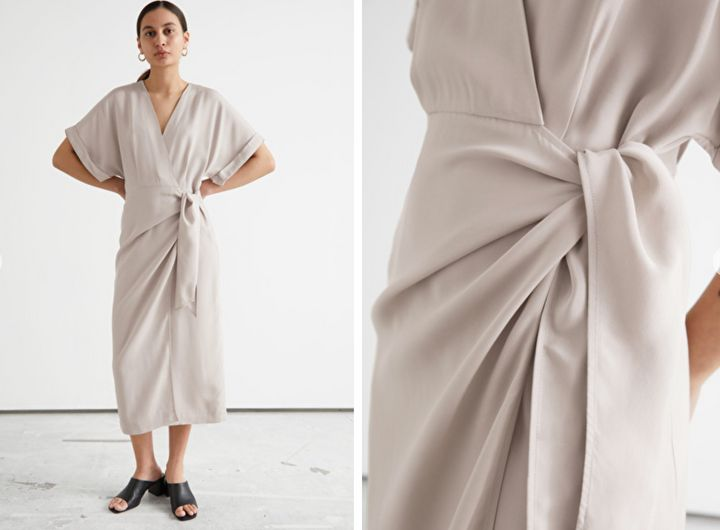 """Fold-up sleeve midi wrap dress from&nbsp;<a href=""""https://go.skimresources.com?id=38395X987171&amp;xs=1&amp;xcust=workclothes-BrittanyWong-060421-&amp;url=https%3A%2F%2Fwww.stories.com%2Fen_usd%2Fclothing%2Fdresses%2Fmidi-dresses%2Fproduct.fold-up-sleeve-midi-wrap-dress-brown.0976186002.html"""" target=""""_blank"""" rel=""""noopener noreferrer"""">&amp; Other Stories,</a> $119."""