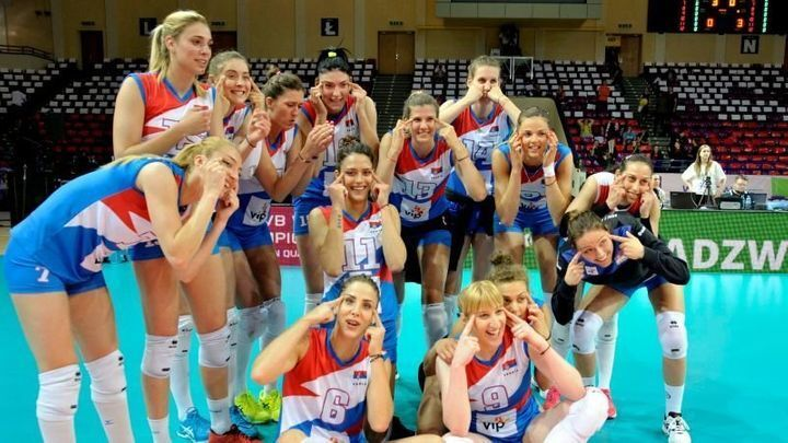 The Serbian women's volleyball team after their win against Poland in 2017. They stretched out their eyes, presumably t