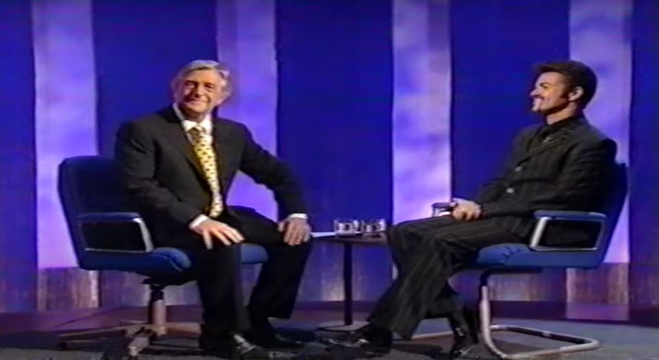George Michael sitting with Michael Parkinson in