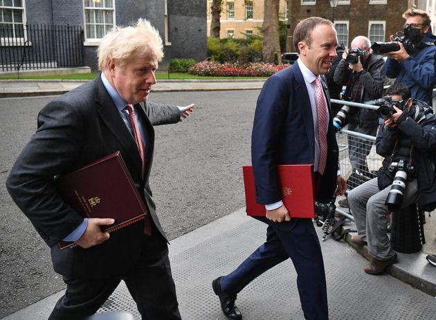 Prime Minister, Boris Johnson and Secretary of State for Health and Social Care, Matt Hancock walk from...