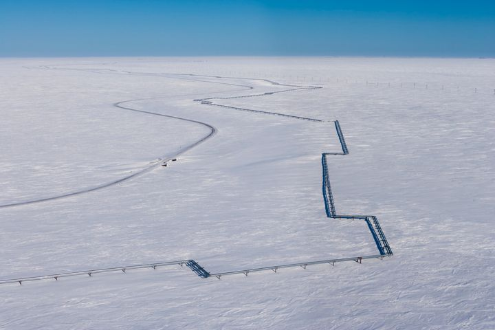 A fossil fuel pipeline near Nuiqsut, Alaska, in the National Petroleum Reserve.