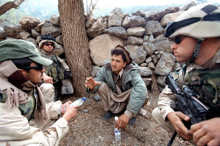 A village suspect is questioned by U.S. soldiers from the 501st Parachute Infantry Regiment with the assistance of an interpr