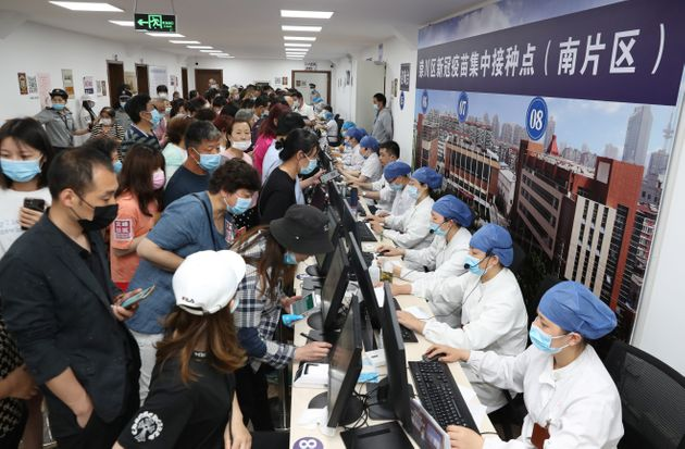 NANTONG, CHINA - JUNE 04: Local residents line up to receive a dose of the COVID-19 vaccine at Hongqiang...