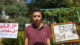 """Palestinian poet and writer Muhammad el-Kurd, one of those facing the loss of their homes and has worked tirelessly to publicise the issue on social media, stands in front of banners in the annexed east Jerusalem neighbourhood of Sheikh Jarrah on June 2, 2021. Arabic slogan on placard (L) reads: """"The right to a home is a sacred right"""". - For decades, Sheikh Jarrah was just another neighbourhood in Israeli-annexed east Jerusalem, but its story has gone viral online since protests flared against the planned expulsion of Palestinians from houses there. (Photo by AHMAD GHARABLI / AFP) (Photo by AHMAD GHARABLI/AFP via Getty Images)"""