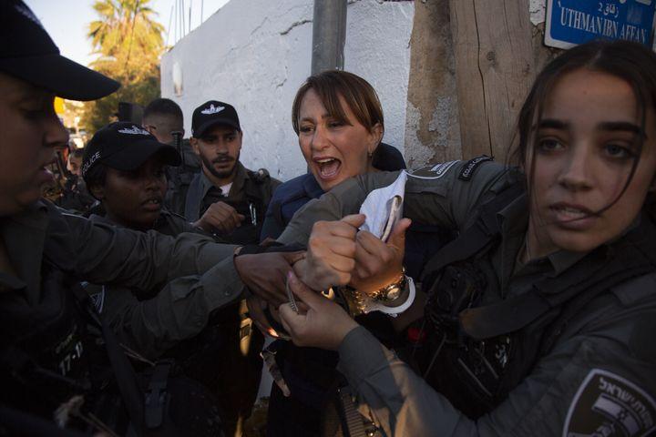 JERUSALEM - JUNE 05: Al Jazeera journalist Givara Budeiri is being taken into custody by Israeli police while she was coverin