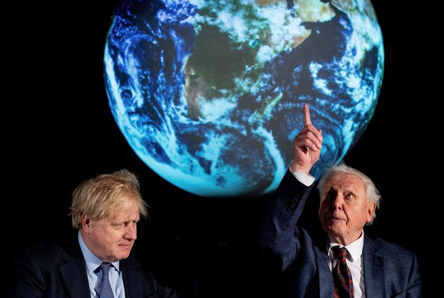 Boris Johnson sits with David Attenborough during an event to launch the United Nations' Climate Change...