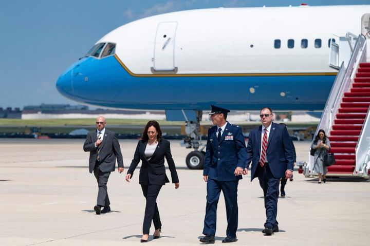 Vice President Kamal Harris walks off Air Force Two at Andrews Air Force Base, on Sunday after her plane was forced to