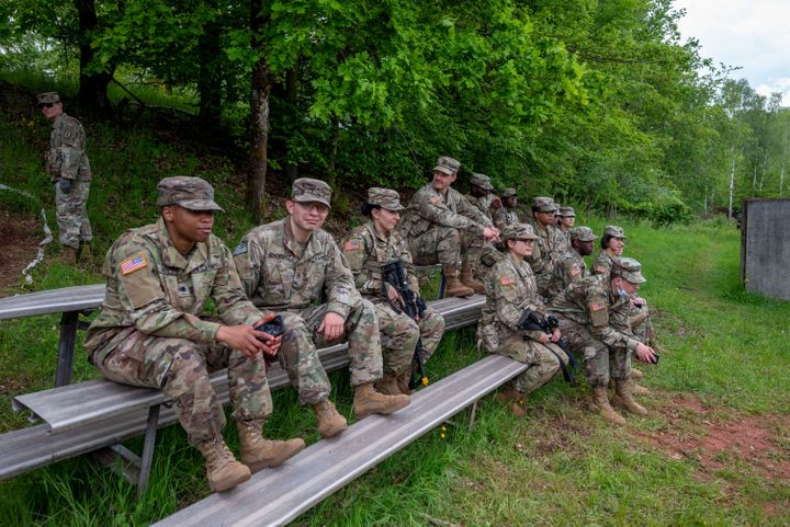 03 June 2021, Rhineland-Palatinate, Baumholder: US soldiers sit on benches during an exercise at the Baumholder military trai