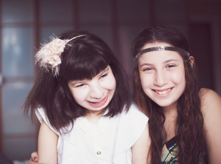 Emma (left), on her 16th birthday, with her sister Hanna (then 12 years old).
