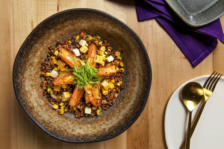 "Chica's ""Grilled Shrimp and Quinoa""with beluga lentils, queso fresco, fire-roasted corn, chile poblano and purple potato sofrito."
