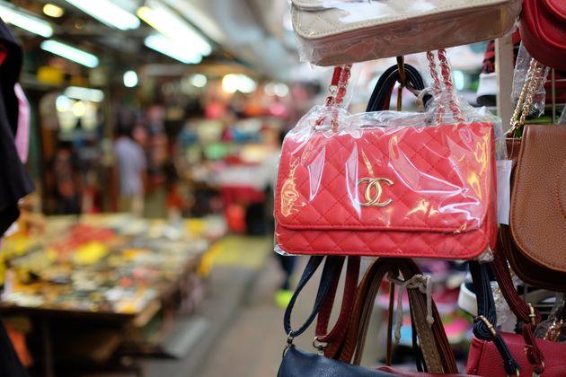 Kuala Lumpur, Malaysia - August 19, 2015: Some fake bags on sale in China Town market in Kuala Lumpur....