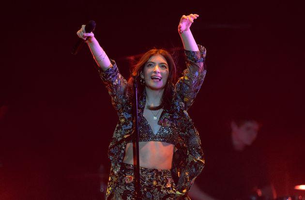 Lorde performing in