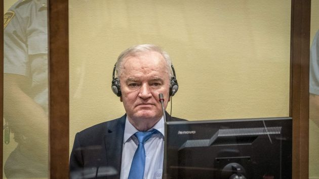 Ex-Bosnian Serb military chief Ratko Mladic sits in the defendant box prior to the hearing of the final...