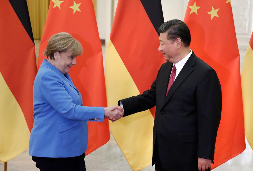 BEIJING, CHINA - MAY 24: China's President Xi Jinping (R) meets German Chancellor Angela Merkel at the...