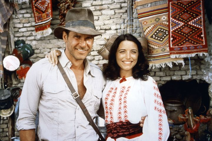 """Harrison Ford and Karen Allen on the set of """"Raiders of the Lost Ark."""""""