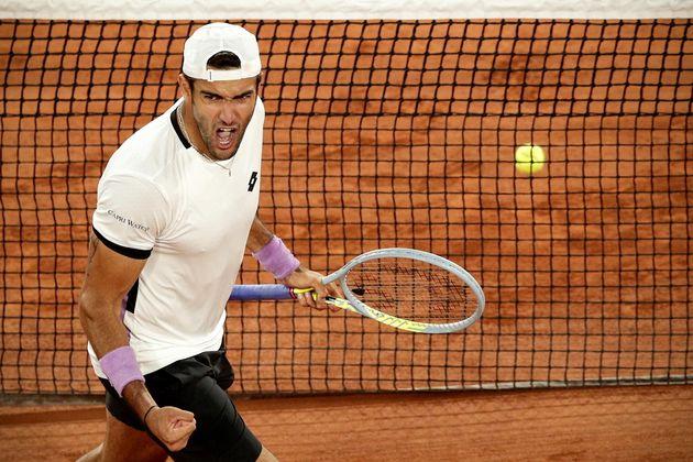 epa09258612 Matteo Berrettini of Italy reacts during his quarter final match against Novak Djokovic of...