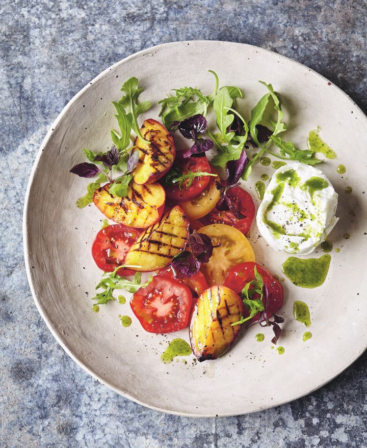 Tomato and chargrilled peach salad with buffalo mozzarella and basil-oil dressing.