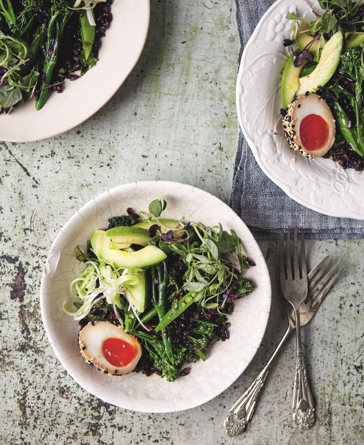 Black rice salad with soy eggs, greens and avocado