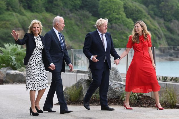 Boris Johnson and his wife Carrie Johnson walk with US president Joe Biden and US first lady Jill...