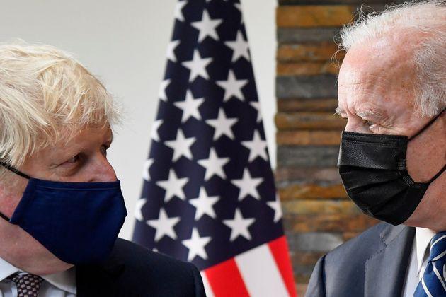 Boris Johnson speaks with US President Joe Biden at the Carbis Bay Hotel,
