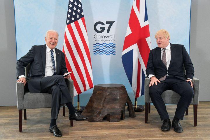 Britain's Prime Minister Boris Johnson (R) and US President Joe Biden pose before a bilateral meeting at Carbis Bay, Cornwall